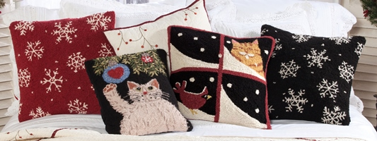 Holiday Pillows on a Bed